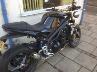 Triumph Speed Triple in black. Low miles, excellent condition, many extras.