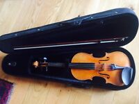 Full size violin, hard bodied case, and bow.