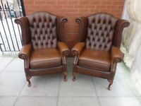 A Pair Of Brown Leather Queen Ann Chesterfield Wing/Arm Chairs