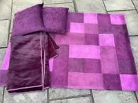 Plum coloured rug, throw and cushions