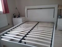 Bari high-gloss white king-size bed with 2 matching bedside chests of drawers.