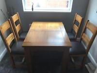 Genuine Teak dining table with chairs immaculate condition