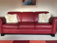Red 3 seater sofa in excellent condition with cream stitching