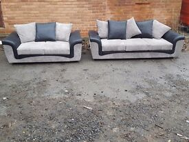 Lovely Brand New black and grey cord 3 and 2 seater sofa suite.small mark at the back.can deliver