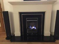 Gas fire complete with immaculate sandstone fireplace and black granite hearth