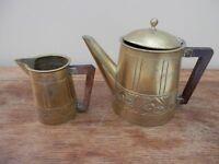 Brass tea/coffeepot and cream jug