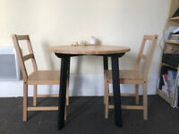 Round wooden black dinings table with 2 wood chairs