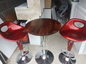 table and 2 bar stools