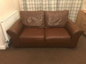 Two seater brown leather sofa