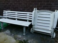 3 sunbeds and bench