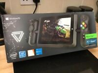 Windows 10 gaming tablet. Hardly used still in original box also comes with tablet case.