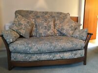 Ercol Two Seater Sofa, Golden Dawn light oak finish, beige/green upholstery