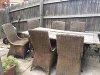 Wrought iron and solid oak garden table set with rattan chairs