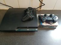 Ps3 Slimline with 2 controllers & 3 games