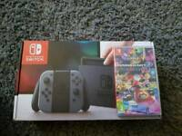 brand new Nintendo switch with Mario Deluxe game