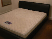 Super king size bed with black faux leather headboard and frame and firm Chirorest mattress included