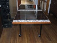 LARGE TILED COFFEE TABLE ON WHEELS