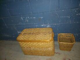brown wicker laundry basket with lid and wicker waste bin