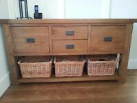 Reclaimed oak hall table with drawers. Includes rattan wicker baskets