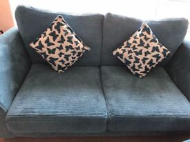 Teal two seater sofa