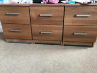 3 brown bedside tables