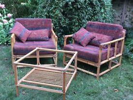 Pair of cane chairs with small table