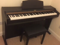 Roland HP101e electric piano. excellent condition, seat and cabinet stand included.