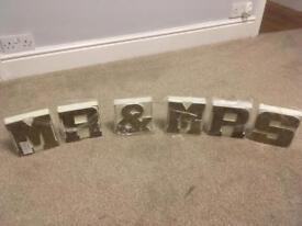 """""""Mr & Mrs"""" wooden block wedding decoration."""