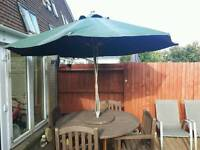 Garden table and chairs and parasol