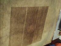 Large brown 100% pure wool rug.