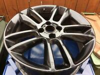 1 Black alloy wheel from a 2014 Vauxhall Corsa both with minor scuff marks