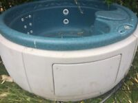large circular hot tub with lid