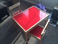 Children's red top table and 2 chairs