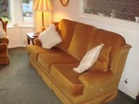 Three piece suite/ 3 Seater sofa plus two matching chairs