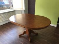 A leaf pine extendable dining table