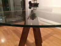 Round dining table with 1.2m glass top and Acacia wood base