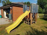 Childrens garden slide and wooden table
