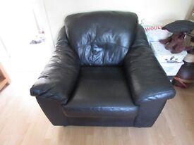 Black soft leather armchair