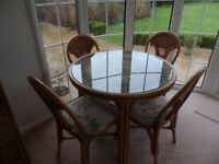 Cane table and four chairs by DARO