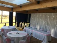 100 x Chair Covers, Starlight Backdrop & LOVE letter hire Bristol. Special Offer price £385.