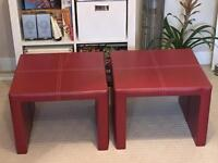 Red faux leather side tables.