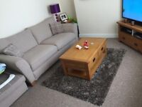 Large sofa, swivel chair and puffy.