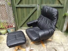 Black recliner chair and matching stool.