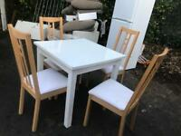 Lovely wooden dining table with four chairs