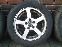 Set of alloys and winter tyres all good legal lots of tread Volvo or ford
