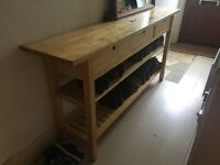 Long narrow hallway table with three drawers and shoe storage