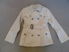 BRAND NEW WITH TAGS NEXT GIRLS STONE COLOURED RAINCOAT - AGE 10 YEARS