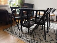 Foldable dining table and 4 foldable chairs