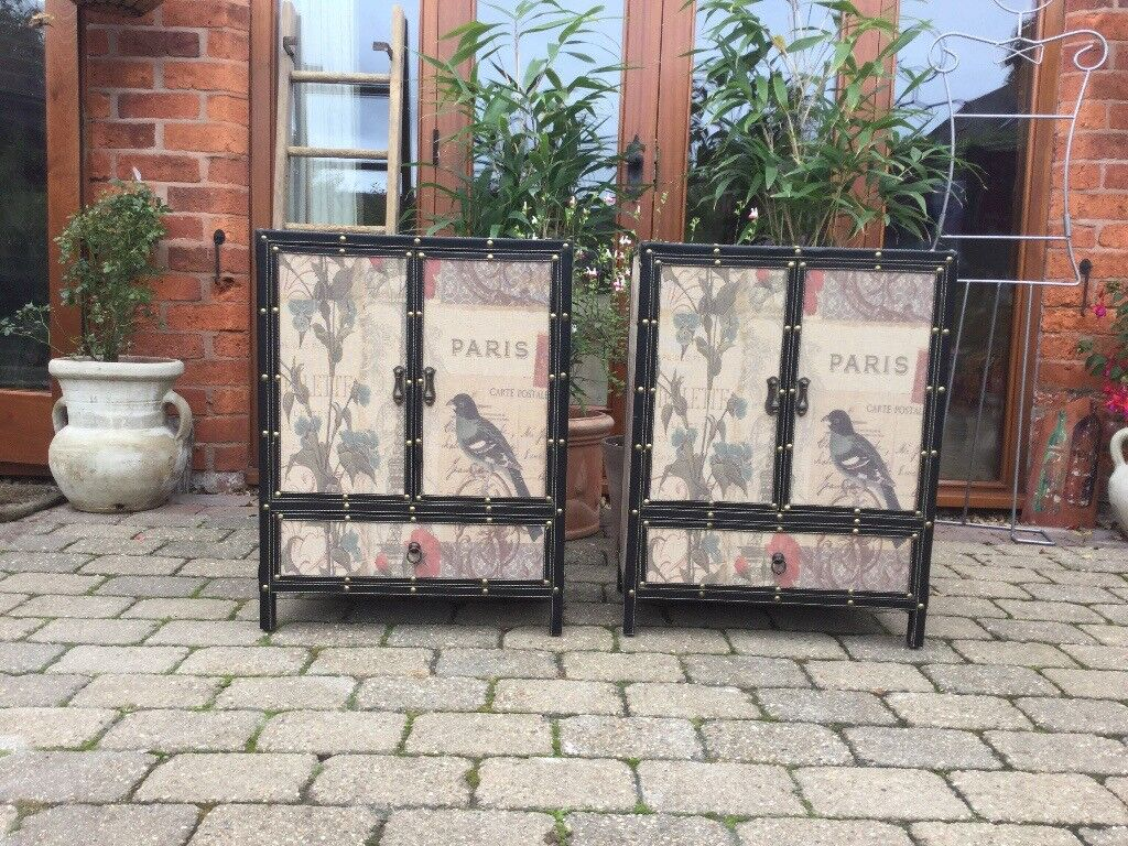 A pair of Beautiful hessian covered cupboards with bird design