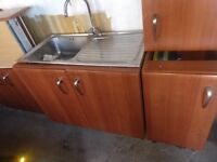 Really nice kitchen units cupboards and sink with mixer tap.